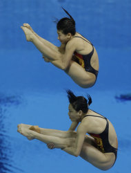 Gold medalists Wu Minxia, front, and He Zi, rear, compete during the 3 Meter Synchronized Springboard final at the Aquatics Centre in the Olympic Park during the 2012 Summer Olympics in London, Sunday, July 29, 2012. (AP Photo/Lefteris Pitarakis)