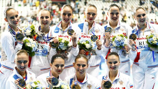 Members of team Russia pose with their gold medals after the women's synchronised swimming free routine combination final at the Aquatics World Championships in Kazan