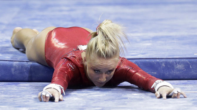Nastia Liukin reacts after falling from the uneven bars during the final round of the women's Olympic gymnastics trials, Sunday, July 1, 2012, in San Jose, Calif. (AP Photo/Jae C. Hong)
