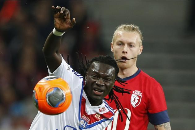 Lille's Kjaer challenges Lyon's Gomis for the ball during their French Ligue 1 soccer match at Pierre Mauroy Stadium in Villeneuve d'Ascq
