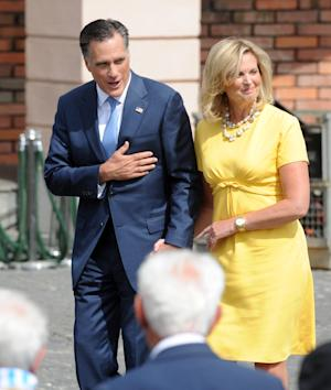 Republican presidential candidate, former Massachusetts Gov. Mitt Romney with wife Ann bows to Polish WWII veterans and a survivor of a Nazi concentration camp prior to laying a wreath at the Warsaw 1944 Uprising monument in Warsaw, Poland, Tuesday, July 31, 2012. (AP Photo/Alik Keplicz)