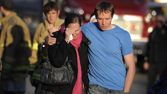 "FILE - In this Dec. 14, 2012 file photo, Alissa Parker, left, and her husband, Robbie Parker,  leave the firehouse staging after receiving word that their six-year-old daughter Emilie was one of the 20 children killed in the Sandy Hook School shooting in Newtown, Conn.  Alissa Parker told ""CBS This Morning"" in an interview that aired Thursday, March 21, 2013, that she wanted to meet with Adam Lanza's father, Peter Lanza, to tell him ""something"" she needed to get out of her system. It's not clear what that something was. CBS planned to show the rest of the interview with Alissa and Robbie Parker on Friday morning revealing more details about their meeting with Peter Lanza.   (AP Photo/Jessica Hill)"