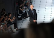 Designer Jason Wu greets the crowd after showing the Jason Wu spring 2013 collection, Friday, Sept. 7, 2012 in New York. (Photo by Diane Bondareff/Invision/AP)