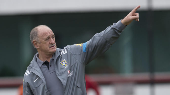 """FILE - In this May 31, 2013 file photo, Brazil's soccer team coach Luiz Felipe Scolari gives instructions to his players during a Brazilian national soccer team training session in Rio de Janeiro, Brazil. Scolari says, """"We all want justice in our country. Those in the government also want this. We can't only crucify. We all want it and we will work together for that. But it doesn't happen in a day. We have to work together to tackle some points so that hopefully in one, two, five or 10 years from now things can change."""" (AP Photo/Silvia Izquierdo, File)"""