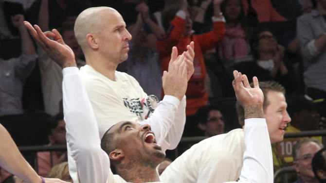 New York Knicks' J.R. Smith, foreground, and Jason Kidd celebrate a goal from the bench during the second half of an NBA basketball game against the Washington Wizards, Tuesday, April 9, 2013, at Madison Square Garden in New York. The Knicks won 120-99. (AP Photo/Mary Altaffer)
