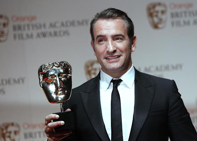 "Actor Jean Dujardin with his award for ""Best Leading Actor' for the film 'The Artist' backstage at the BAFTA Film Awards 2012, at The Royal Opera House in London, Sunday, Feb. 12, 2012. (AP Photo/Joel Ryan)"