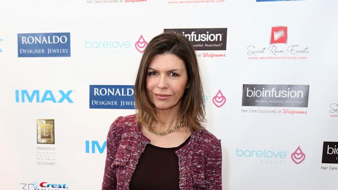 IMAGE DISTRIBUTED FOR CREST WHITESTRIPS - In this photo from Crest Whitestrips, Finola Hughes flashes her dazzling white, bright smile at the Red Carpet Celebrity Retreat, SLS Hotel, on Thursday, Feb. 21, in Los Angeles. (Photo by Casey Rodgers/Invision for Crest Whitestrips)