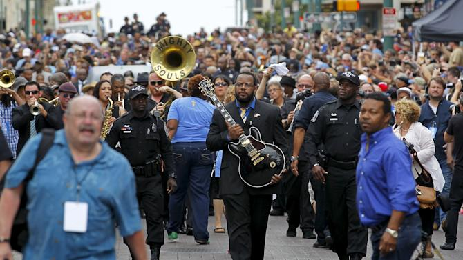 """Rodd Bland, son of Bobby """"Blue"""" Bland, carries the iconic Gibson guitar named """"Lucille"""" belonging to the late B.B. King during a procession down Beale Street in Memphis, Tennessee"""