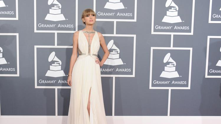 FILE - This Feb. 10, 2013 file photo shows Taylor Swift at the 55th annual Grammy Awards in Los Angeles. Prom season provides many girls a chance to have their moment in the spotlight. It's likely that this year's parade of fashions will include a few celebrity lookalikes. (Photo by Jordan Strauss/Invision/AP)