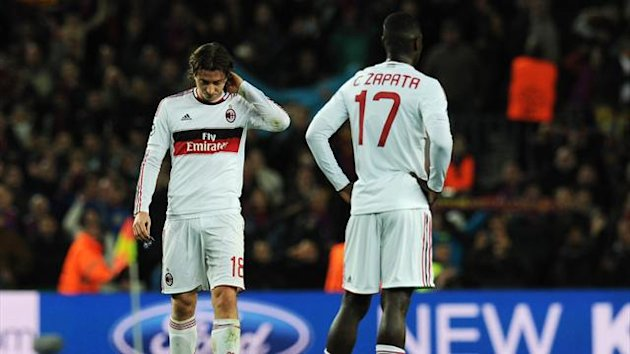 Milan's Montolivo and Zapata during 4-0 loss to Barcelona