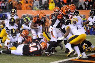 Jeremy Hill ran for a score but he'll be remembered for a huge turnover. (USA Today Sports)