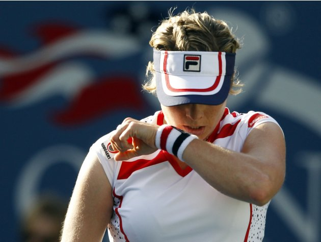 Kim Clijsters of Belgium wipes her face during her match against Laura Robson of Great Britain in the second round of play at the 2012 US Open tennis tournament,  Wednesday, Aug. 29, 2012, in New York
