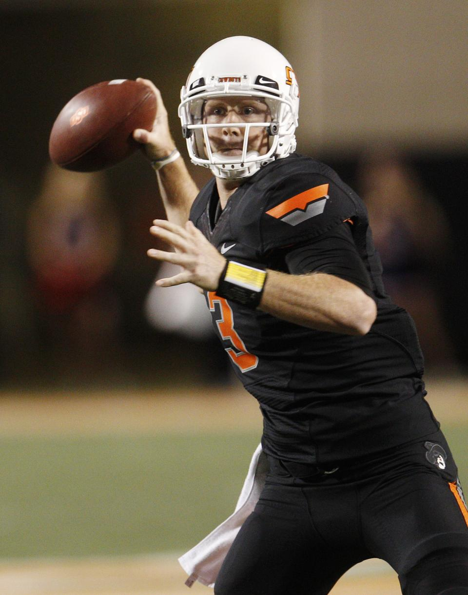 Oklahoma State quarterback Brandon Weeden passes against Arizona in the third quarter of an NCAA college football game in Stillwater, Okla., Thursday, Sept. 8, 2011. (AP Photo/Sue Ogrocki)