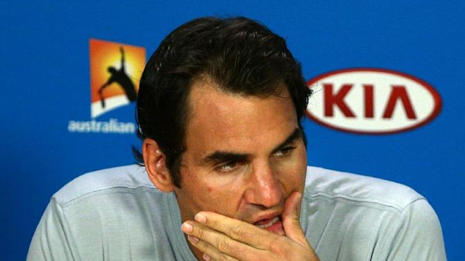 Roger Federer of Switzerland reacts during a press conference after his third round loss to Andreas Seppi of Italy at the Australian Open tennis championship in Melbourne, Australia, Friday, Jan. 23, 2015. (AP Photo/Rob Griffith)