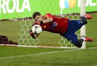 Spain's goalkeeper and captain Iker Casillas takes part in a training session on October 15, the eve of the FIFA World Cup 2014 qualifying game against France at Vicente Calderon stadium in Madrid. The match between Spain and France is the headline clash in Europe Tuesday, while the games between Italy and Denmark, Germany and Sweden, and England and Poland could all have surprises in store