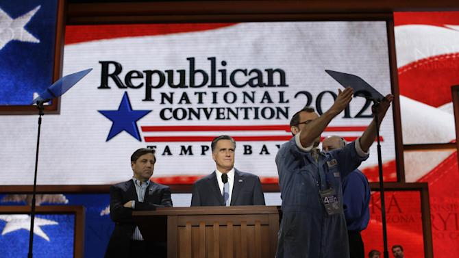 Republican presidential nominee Mitt Romney looks over the placement of the teleprompter during a sound check at the Republican National Convention in Tampa, Fla., on Thursday, Aug. 30, 2012. (AP Photo/Charles Dharapak)