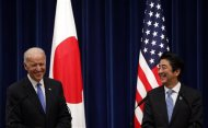 U.S. Vice President Joe Biden (L) and Japan's Prime Minister Shinzo Abe exchange smiles during a joint news conference following their meeting at the prime minister's official residence in Tokyo December 3, 2013. REUTERS/Toru Hanai