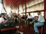 Tourists enjoy the ride on board the &quot;Islamorada&quot; boat in Panama City on April 15. For $165 for a full 50-mile (80 kilometer) trip or $115 for a shorter version, visitors get to go through the canal, but are also transported back to a time when the boat supplied an underground world, shipping black market booze back to the hidden speakeasies of Capone&#39;s Chicago