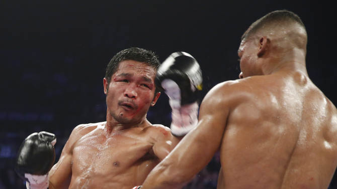 Yuriorkis Gamboa, from Miami, Fla., right, and Michael Farenas, from the Philippines, trade blows during their WBA interim super featherweight title fight Saturday, Dec. 8, 2012, in Las Vegas. (AP Photo/Eric Jamison)