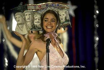 Becky Leeman ( Denise Richards ) shows off her fabulous headgear in Drop Dead Gorgeous