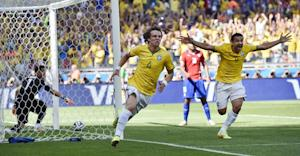 Brazil's David Luiz, left, and Fred celebrate after…