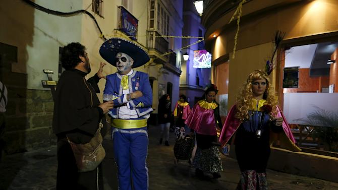 Revellers in fancy costumes are seen during the Carnival of Cadiz, southern Spain