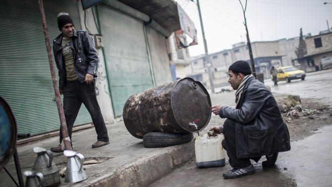 People sell fuel in the streets of Aleppo, Syria, Saturday, Jan. 5, 2013. The revolt against President Bashar Assad that started in March 2011 began with peaceful protests but morphed into a civil war that has killed more than 60,000 people, according to a recent United Nations recent estimate. (AP Photo/ Andoni Lubaki)