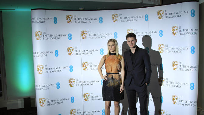British actors Jeremy Irvine and Alice Eve pose during a photo call after announcing the nominations for the EE British Academy Film Awards in 2013 at BAFTA Headquarters in Piccadilly, central London, Wednesday, Jan. 9, 2013. (Photo by Joel Ryan/Invision/AP)