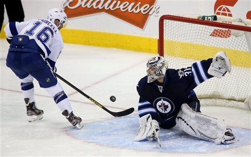 Ladd scores 2 goals, Jets top Lightning in SO