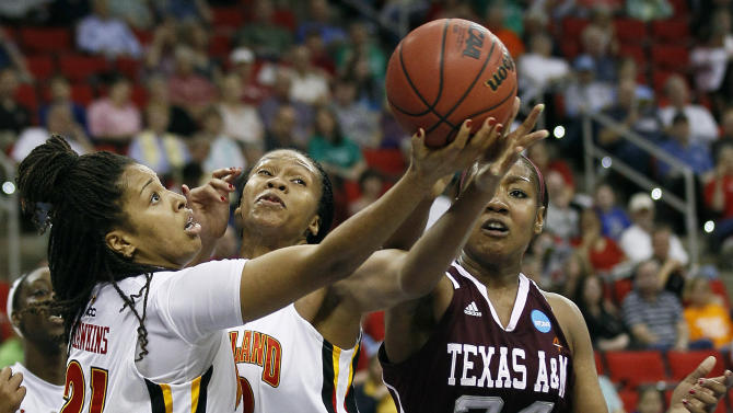 Maryland's Tianna Hawkins (21) and Alicia DeVaughn reach for a rebound against Texas A&M's Karla Gilbert (34) during the first half of an NCAA women's tournament regional semifinal college basketball game in Raleigh, N.C., Sunday, March 25, 2012. (AP Photo/Gerry Broome)