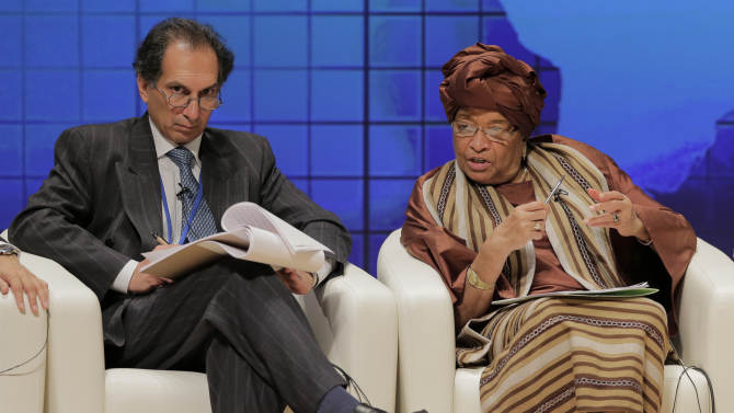 Liberia's President Ellen Johnson Sirleaf, right, speaks as Deputy Director in the Global Economy and Development Program Homi Kharas listens during a seminar at the IMF and World Bank annual meetings in Tokyo, Saturday, Oct. 13, 2012.(AP Photo/Itsuo Inouye)