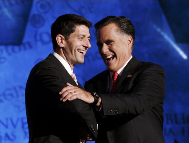 Republican presidential nominee Mitt Romney shakes hands with vice presidential running mate Rep. Paul Ryan (L) after accepting the nomination during the final session of the Republican National Convention in Tampa, Florida August 30, 2012.