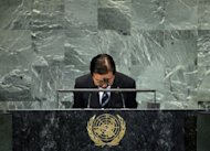 "Yoshihiko Noda, Prime Minister of Japan, bows at the end of his speech during the 67th session of the United Nations General Assembly at UN headquarters in New York. China criticised Noda's ""obstinate persistence"" after he insisted there could be no compromise with Beijing on the ownership of disputed islands"