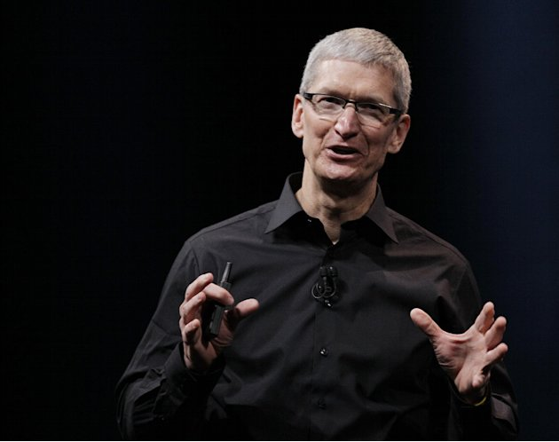 In this Wednesday, Sept. 12, 2012 photo, Apple CEO Tim Cook speaks during an introduction of the new iPhone 5 in San Francisco. Cook is scheduled to testify on Capitol Hill Tuesday May 21, 2013, to ex