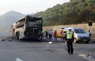A total of 36 bodies were pulled from the charred shell of the bus following the crash near Yanan in northern China's Shaanxi province. The driver and passenger of the tanker were taken into police custody, Xinhua said
