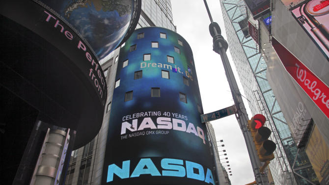 In this March 15, 2011 photo, a curved seven story video billboard is an iconic feature of the NASDAQ Stock Market site building in Times Square, New York. Nasdaq OMX, the parent company of the Nasdaq Stock Market, is teaming up with IntercontinentalExchange Inc. to make an approximately $11.3 billion counteroffer Friday, April 1, 2011, for the New York Stock Exchange. (AP Photo)