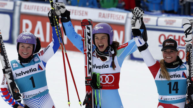 Slovenia's Tina Maze , center, winner of the alpine ski womens's World Cup giant slalom, celebrates with second placed France's Tessa Worley, left, and Switzerland's Lara Gut, third, in Lenzerheide, Switzerland , Sunday, March 17, 2013. (AP Photo/Alessandro Trovati)