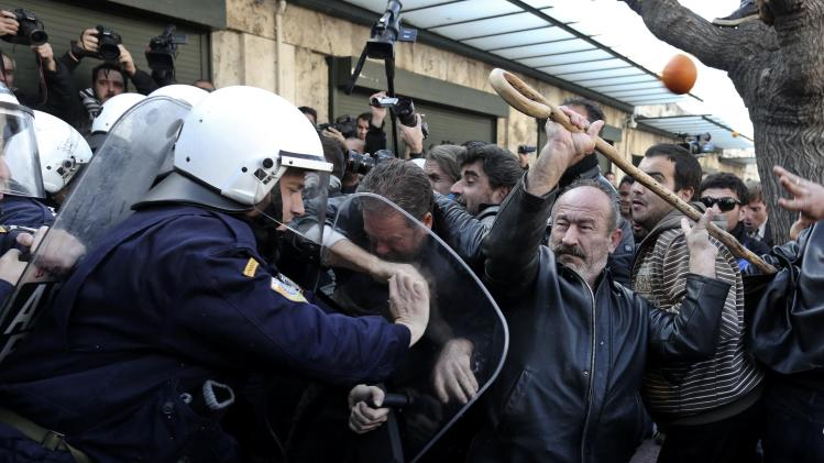 Farmers argue with policemen during a rally in Athens