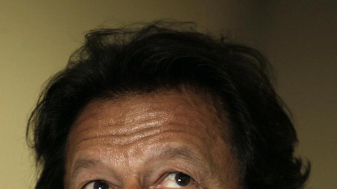 """In this Friday, March 22, 2013, photo, Pakistani cricket legend-turned politician Imran Khan, speaks during an interview with The Associated Press in Lahore, Pakistan. Pakistani cricket legend-turned politician Imran Khan rallied around 100,000 flag-waving supporters in the eastern city of Lahore on Saturday ahead of a historic national election later this spring.  """"This is going to swing the election,"""" Khan told The Associated Press in an interview before the rally. """"The youth is standing with us and change.""""  (AP Photo/K.M. Chaudary)"""
