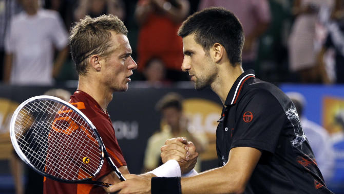 Novak Djokovic of Serbia, right, shakes hands with Lleyton Hewitt of Australia,    after Djokovic won their fourth round match at the Australian Open tennis championship, in Melbourne, Australia, early Tuesday, Jan. 24, 2012.(AP Photo/Aaron Favila)