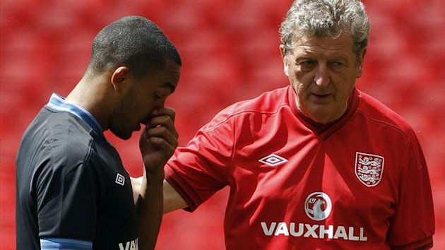 Theo Walcott and Roy Hodgson of England