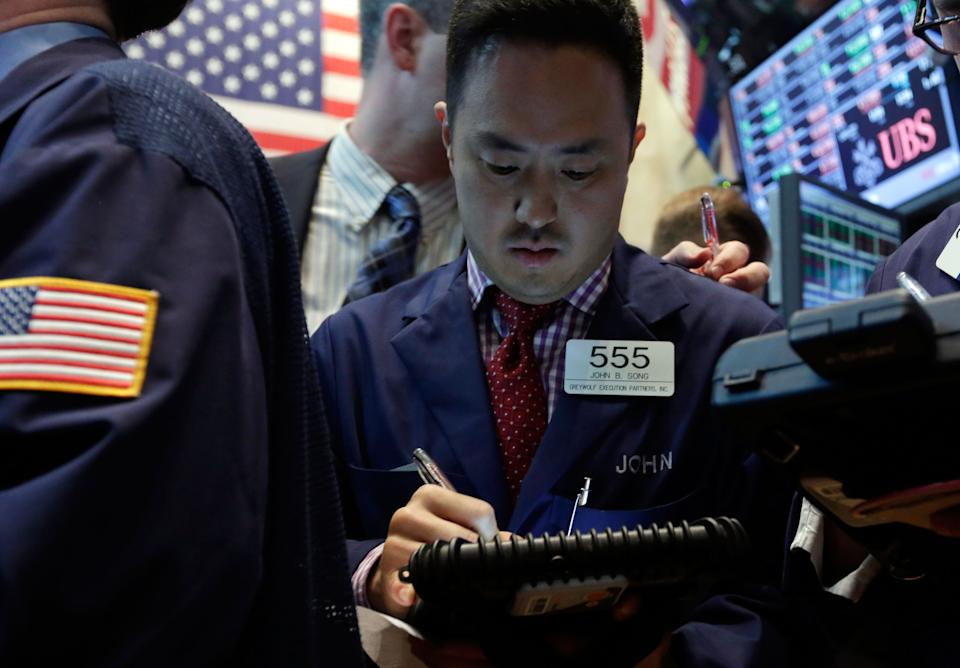 Trader John Song works on the floor of the New York Stock Exchange Thursday, May 23, 2013. A global stock market slump is continuing on Wall Street as traders worry about how committed the Federal Reserve remains to keeping up its bond-buying program. (AP Photo/Richard Drew)