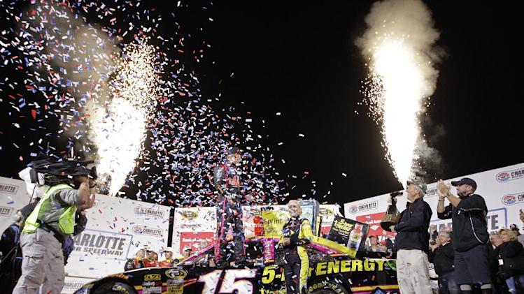 Clint Bowyer, center, celebrates in victory lane after winning the NASCAR Bank of America 500 Sprint Cup series auto race in Concord, N.C., Saturday, Oct. 13, 2012. (AP Photo/Chuck Burton)