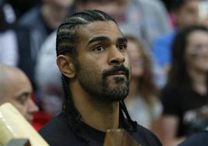 English boxer Haye stands on the sideline before the Minnesota Vikings met the Pittsburgh Steelers in their NFL football game at Wembley Stadium in London