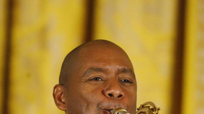 FILE - In this June 15, 2009 file photo, Jazz musician Branford Marsalis plays the saxophone during a jazz workshop studio for students hosted by first lady Michelle Obama, not pictured, in the East Room of the White House in Washington.  Marsalis is a recipient of the 2012 Jefferson Award. (AP Photo/Charles Dharapak)