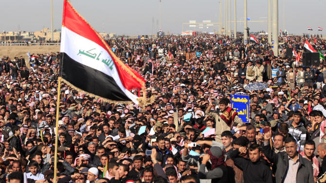Protesters chant slogans against Iraq's Shiite-led government as they wave national flags during a demonstration in Fallujah, 40 miles (65 kilometers) west of Baghdad, Iraq, Friday, Dec. 28, 2012. Thousands of Iraqi Sunnis massed along a major western highway and in other parts of the country Friday for what appear to be the largest protests yet in a week of demonstrations, intensifying pressure on the Shiite-led government. (AP Photo/Karim Kadim)