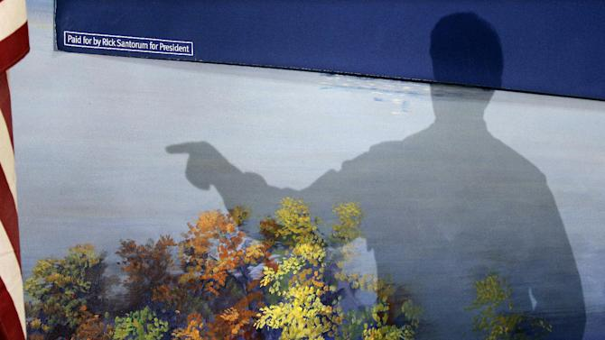 The shadow of Republican presidential candidate, former Pennsylvania Sen. Rick Santorum is cast as he speaks at Froehlich's Classic Corner, Monday, Feb. 20, 2012, in Steubenville, Ohio.  (AP Photo/Eric Gay)