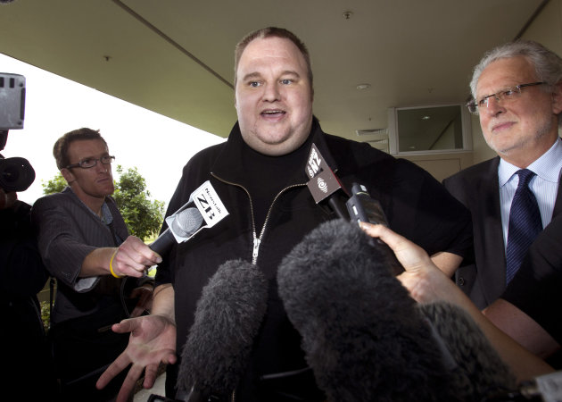 FILE - In this Feb. 22, 2012 file photo, Kim Dotcom, the founder of the file-sharing website Megaupload, comments after he was granted bail and released in Auckland, New Zealand. Indicted Megaupload founder Kim Dotcom has launched a new file-sharing website in a defiant move against the U.S. prosecutors who accuse him of facilitating massive online piracy. The colorful entrepreneur unveiled the &quot;Mega&quot; site ahead of a lavish gala and press conference planned at his New Zealand mansion on Sunday night, Jan. 20, 2013. (AP Photo/New Zealand Herald, Brett Phibbs, File) NEW ZEALAND OUT, AUSTRALIA OUT