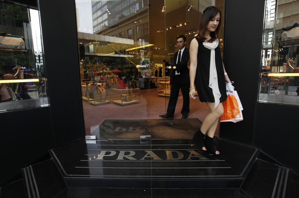 A woman walks out of a Prada store in Hong Kong Sunday, June 12, 2011. Prada and its bankers say an international roadshow to promote the Italian fashion house's upcoming Hong Kong IPO is going well despite recent turmoil in world stock markets. Prada is selling some 423.3 million shares in an initial public offering this month. (AP Photo/Vincent Yu)