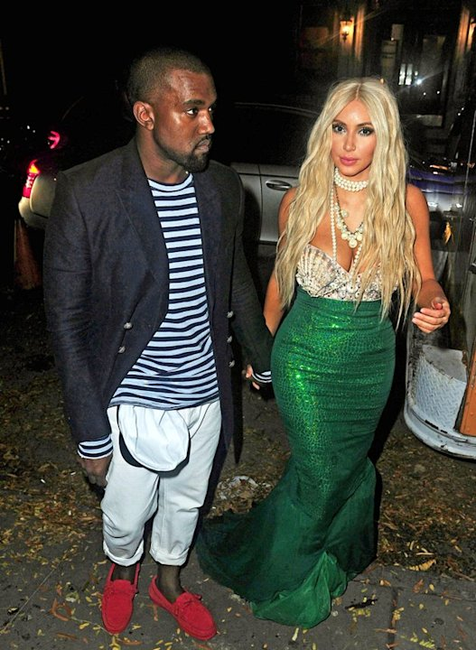 Kim Kardashian donned a glittering tail, seashell bodice, and a blond wig as she dressed up as a mermaid  more like the &quot;Splash&quot; mermaid Madison, not &quot;The Little Mermaid's&quot; Ariel, as she specified on